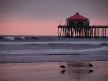 заход солнца пристани huntington пляжа Стоковые Изображения RF