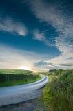 заход солнца проселочной дороги Стоковые Изображения