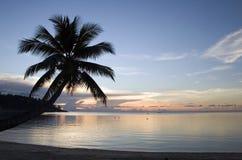 заход солнца рая пляжа стоковое изображение rf