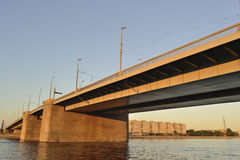 заход солнца реки моста Стоковая Фотография
