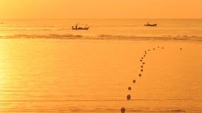 заход солнца рыболовства шлюпки Стоковая Фотография