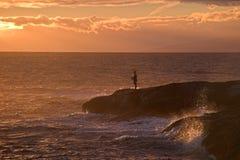 заход солнца рыболовства Стоковые Изображения