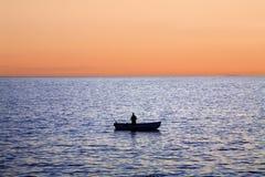 заход солнца рыболовства Стоковое Изображение RF