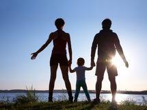 заход солнца семьи Стоковое Изображение RF