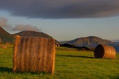 заход солнца сена поля bales Стоковое фото RF