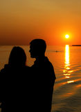 заход солнца силуэта семьи Стоковая Фотография