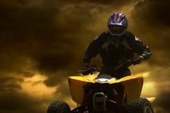 заход солнца силуэта motorcyclist Стоковое фото RF