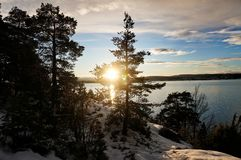 Заход солнца, снег и море стоковые фотографии rf