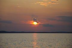 заход солнца солнца облака смешной сидя Стоковые Фото