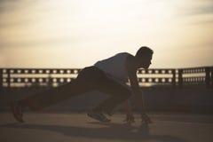 заход солнца спортсмена Стоковые Фото