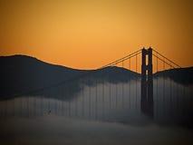 заход солнца строба моста золотистый Стоковое Изображение RF