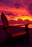 заход солнца стула стоковое фото