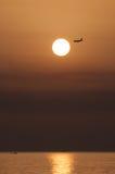 Заход солнца с самолетом Стоковые Фото