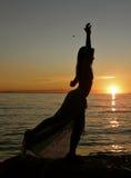 заход солнца танцора Стоковые Изображения