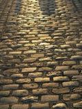 заход солнца улицы булыжника Стоковые Изображения