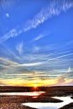 заход солнца устрицы кроватей стоковая фотография rf