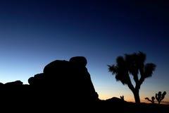заход солнца утеса Стоковая Фотография