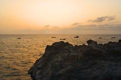 заход солнца утесов puntas las fisherboats el высокий Стоковая Фотография RF