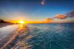 заход солнца фиоритуры пляжа залива Стоковая Фотография RF