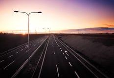 заход солнца хайвея стоковое изображение