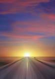 заход солнца хайвея Стоковая Фотография