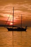 заход солнца шлюпки Стоковые Изображения RF