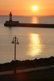заход солнца 2 маяков стоковое фото rf