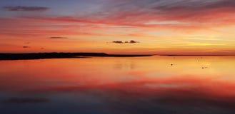 Заход солнца Aberdovey Уэльс Великобритания стоковое изображение rf