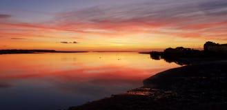 Заход солнца Aberdovey Уэльс Великобритания стоковое фото