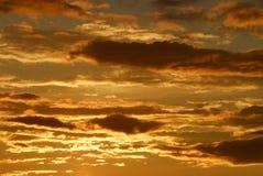 заход солнца cloudds Стоковые Фото
