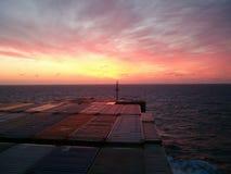 заход солнца containership моста Стоковые Изображения