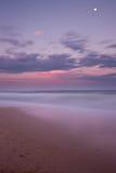 заход солнца dicky пляжа Стоковая Фотография