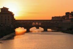 заход солнца florence моста Стоковое фото RF