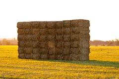 заход солнца haystack Стоковая Фотография