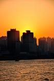 заход солнца Hong Kong зданий стоковое фото rf