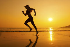 заход солнца jogger Стоковые Изображения RF