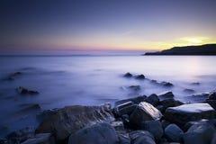 заход солнца kimmeridge залива Стоковая Фотография RF