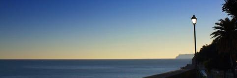 заход солнца lamppost Стоковая Фотография RF