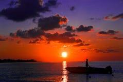 заход солнца negril ямайки рыболовства стоковая фотография rf