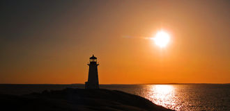 заход солнца peggy s маяка бухточки стоковое фото rf