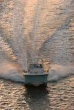 заход солнца powerboat Стоковое фото RF