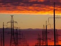 Заход солнца/Powerlines лавы стоковая фотография
