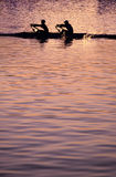 заход солнца rowing Стоковое Фото