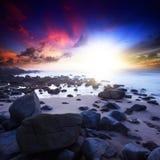 заход солнца singh плащи-накидк пляжа Стоковое Фото