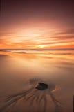 заход солнца береговой породы Стоковые Фотографии RF