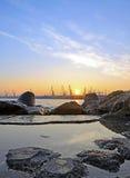 Заход солнца в порте Стоковое Фото