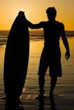 заход солнца занимается серфингом вверх Стоковое Изображение