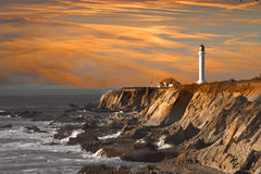 заход солнца маяка Стоковая Фотография