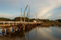 заход солнца моста пляжа Стоковые Фотографии RF