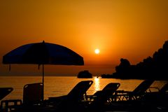 заход солнца острова corfu пляжа Стоковые Фотографии RF
